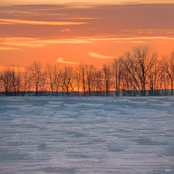 Textures in the snowy field and the accents in the sky, as if quotation marks, are what drew me most to this colorful twilight scene.